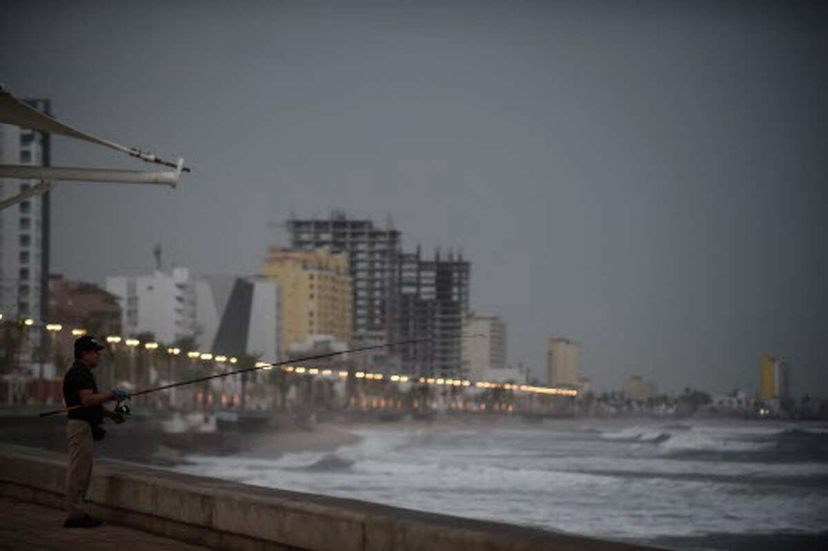 A man fishes at Mazatlan's coastline, in Sinaloa state, Mexico, on October 23, 2018, before the arrival of Hurricane Willa.