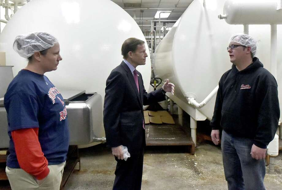 Milford, Connecticut - Tuesday, October 23, 2018: Sara Buck, left, and her brother Chris Buck, right, both of Buck's Ice Cream manufacturing plant in Milford, give U.S. Senator Richard Blumenthal (D-Conn.), center, a tour of the plant on Pepe's Farm Road Tuesday morning. Buck's Ice Cream was awarded the Small Business Adminstration 2018 Family Owned Connecticut Business of the Year. Photo: Peter Hvizdak / Hearst Connecticut Media / New Haven Register