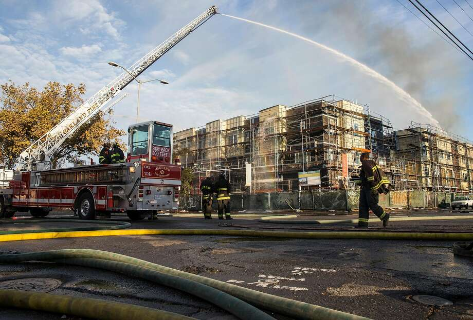 Crews battle a massive blaze that destroyed six apartment buildings in different phases of construction near West Grand Avenue and Filbert Street in Oakland, Calif. Tuesday, Oct. 23, 2018. Photo: Jessica Christian / The Chronicle