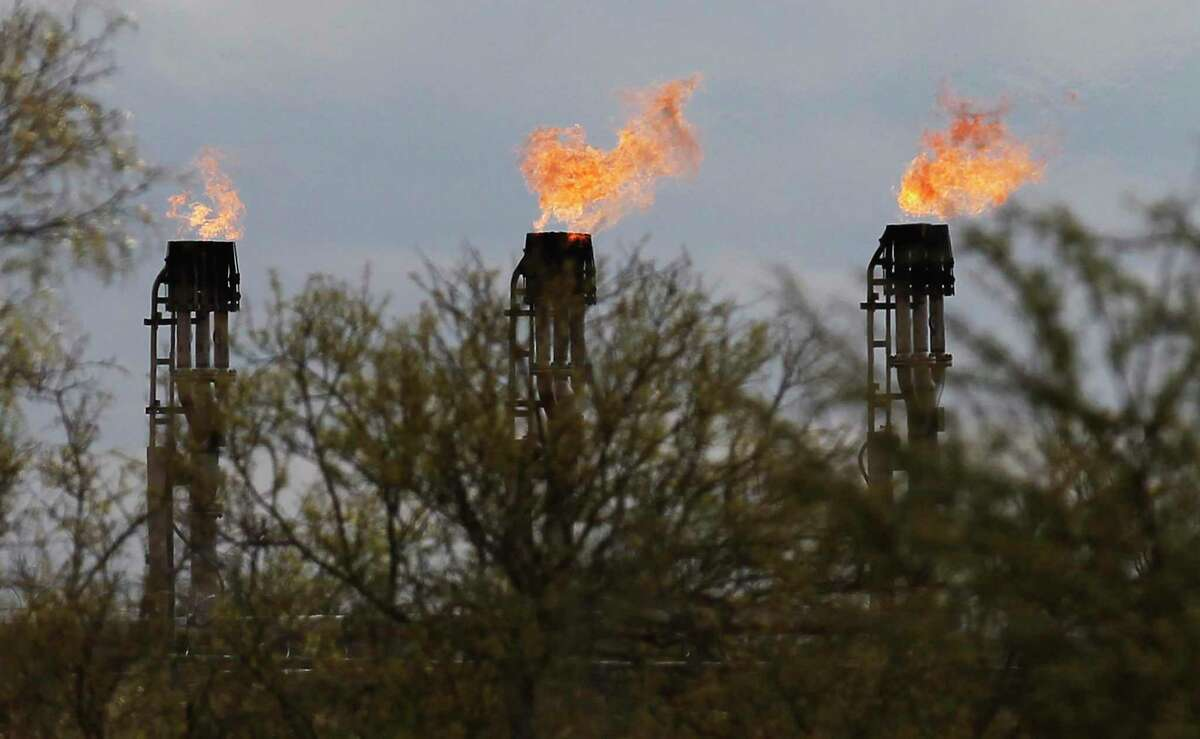 Gas flares burn at Ritchie Farms, an oil lease in La Salle and Dimmit counties, operated by EP Energy E&P Company, L.P. on Thursday, Dec. 11, 2014. The oil drilling operation has burned more than 800 million cubic feet of gas in the first seven month of 2014 which is about a fifth of the total gas production at the lease. Ritchie Farms is one of the top sources of flaring in the Eagle Ford according to data obtained from the Texas Railroad Commission. (Kin Man Hui/San Antonio Express-News)