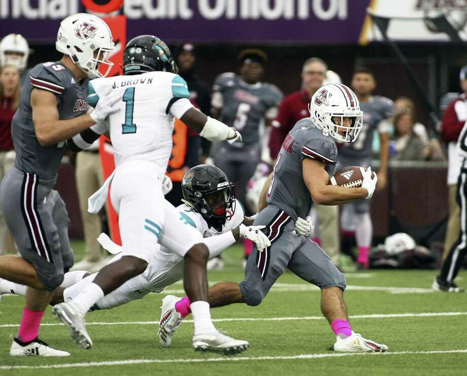 UMass receiver Andy Isabella, right, has 1,013 receiving yards this season — tied for best in the nation with Hawaii's John Ursua. Photo: J. Anthony Roberts / Associated Press / The Republican