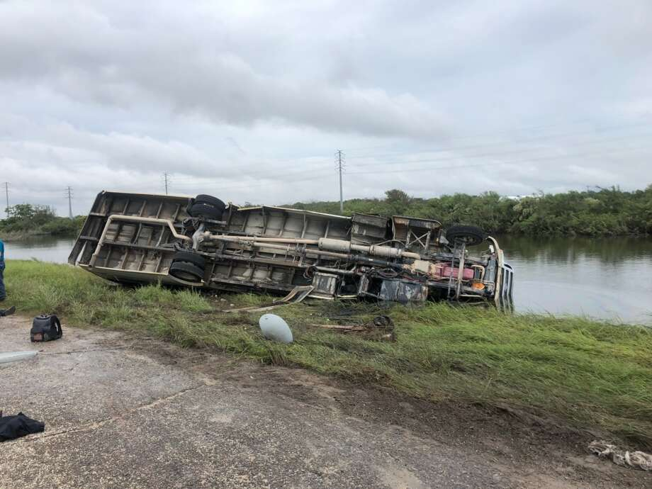 A man is dead after a bus carrying some 30 construction workers flipped Tuesday afternoon in Freeport. Photo: Ray Garivey / Freeport Police Department