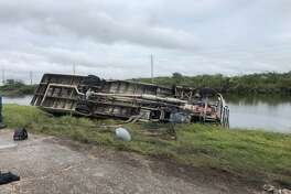 A man is dead after a bus carrying some 30 construction workers flipped Tuesday afternoon in Freeport.