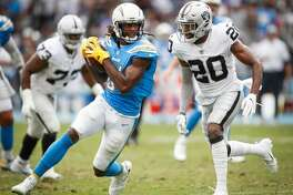 CARSON, CA - OCTOBER 07: Defensive back Obi Melifonwu #20 of the Oakland Raiders looks to tackle wide receiver Mike Williams #81 of the Los Angeles Chargers in the third quarter at StubHub Center on October 7, 2018 in Carson, California. (Photo by Sean M. Haffey/Getty Images)