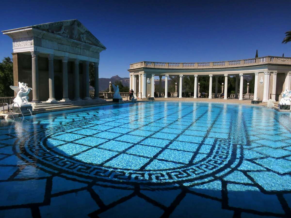 This Aug. 30, 2013 photo shows ancient Roman columns, dating from the first to fourth centuries, surrounding the Hearst Castle's Neptune Pool, on newspaper publisher William Randolph Hearst's 165-room estate in San Simeon, Calif. (AP Photo/Jim MacMillan)