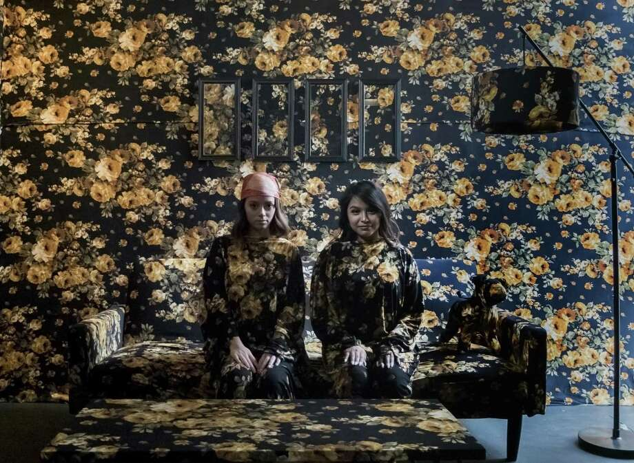 Abby Marin (right) and Sarah Garcia pose for a photo in one of several rooms at the Flower Vault. Photo: Kin Man Hui, Staff / San Antonio Express-News / ©2018 San Antonio Express-News
