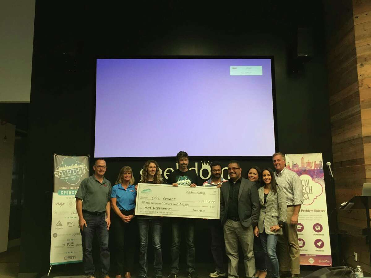 Livia and Radu Istrate, center, won the top prize at the SmartSA Datathon competition on Oct. 19-21, 2018. They called their team