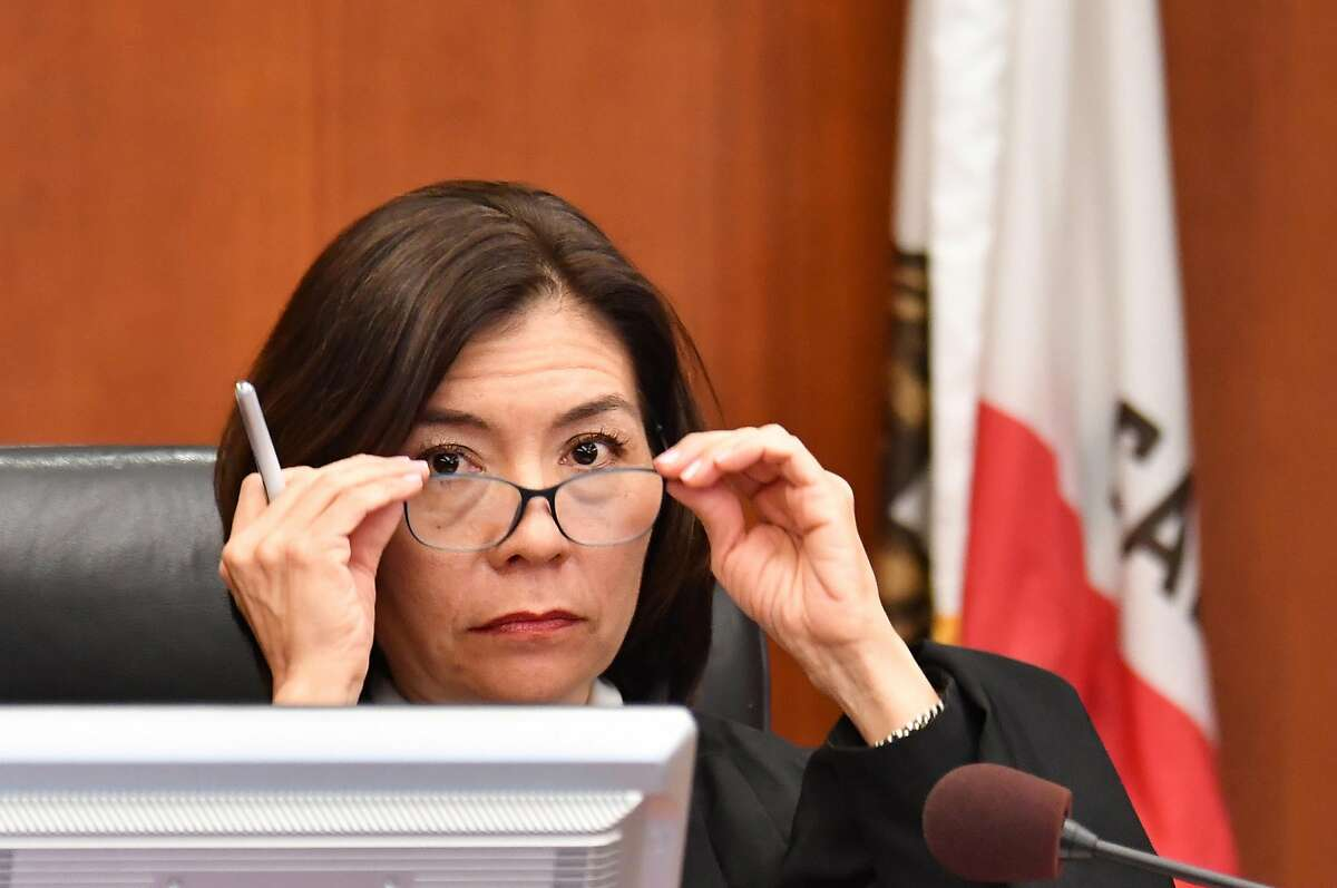 """San Francisco Superior Court Judge Suzanne Ramos Bolanos reads the verdict in the case against Monsanto at the Superior Court Of California in San Francisco, California, on August 10, 2018. - A California jury on Friday, August 10, 2018 ordered agrochemical giant Monsanto to pay nearly $290 million for failing to warn a dying groundskeeper that its weed killer Roundup might cause cancer. Jurors found Monsanto acted with """"malice"""" and that its weed killers Roundup and the professional grade version RangerPro contributed """"substantially"""" to Dewayne Johnson's terminal illness. (Photo by JOSH EDELSON / POOL / AFP) (Photo credit should read JOSH EDELSON/AFP/Getty Images)"""