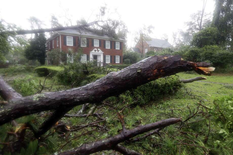 A Wilmington, N.C. home imperiled by a tree toppled in Hurricane Florence in September 2018. Photo: Chuck Burton / Associated Press / Copyright 2018 The Associated Press. All rights reserved