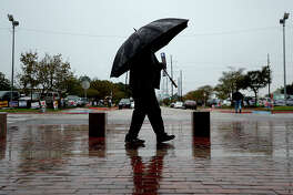 A steady flow of umbrellas were seen surrounding the Jefferson County Courthouse as visitors and workers sheltered from a steady rain throughout the day Tuesday. Photo taken Tuesday, October 23, 2018 Kim Brent/The Enterprise
