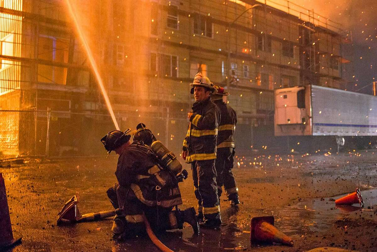 A massive fire consumes an apartment building under construction at Filbert and Grand Ave. in West Oakland, CA.