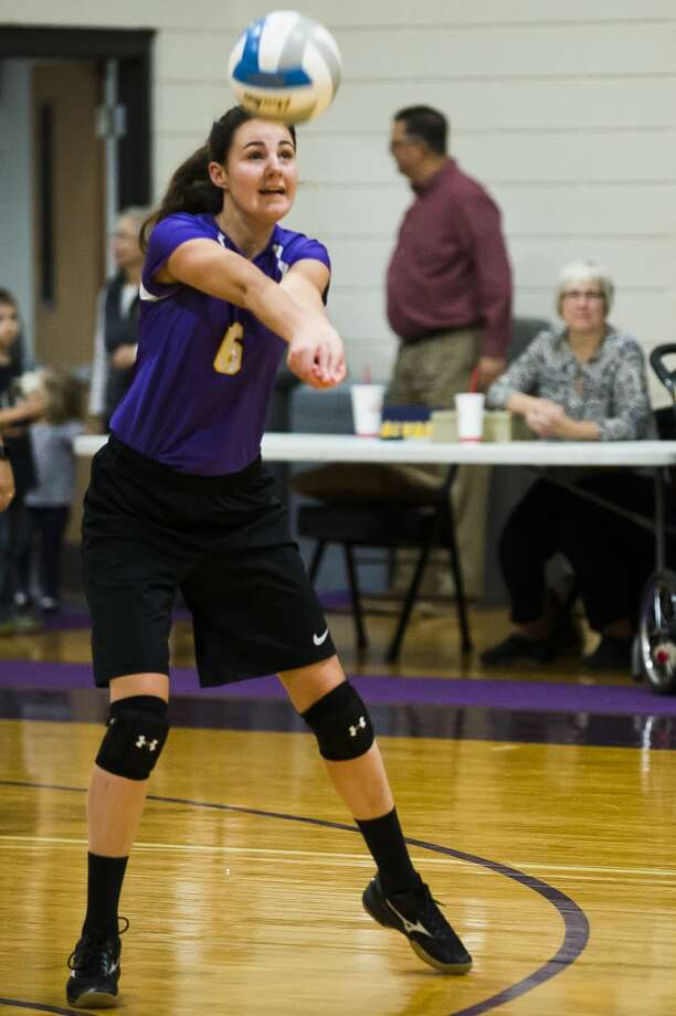 Calvary Baptist senior Cassady Holdeman bumps the ball during a game against Faith Baptist on Tuesday, Oct. 23, 2018 at Calvary Baptist Academy. (Katy Kildee/kkildee@mdn.net) Photo: (Katy Kildee/kkildee@mdn.net)