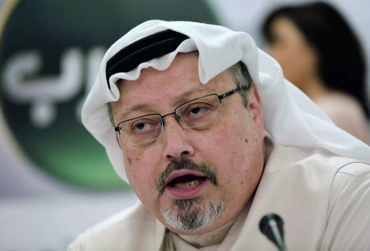 FILE - In this Feb. 1, 2015 file photo, Saudi journalist Jamal Khashoggi speaks during a news conference in Manama, Bahrain. Saudi Arabia is moving ahead with plans to hold a glitzy investment forum that kicks off Tuesday, Oct. 23, 2018, despite some of its most important speakers pulling out in the global outcry over the killing of Khashoggi. The meeting was intended to draw leading investors who could help underwrite Crown Prince Mohammed bin Salman?'s ambitious plans to revamp the economy. (AP Photo/Hasan Jamali, File)