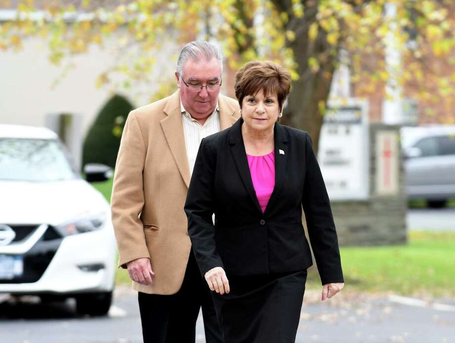 Colonie Town Supervisor Paula Mahan is accompanied by her husband Joseph as they enter the Latham Community Baptist Church polling place on Tuesday, Nov. 7, 2017, in Colonie, N.Y. (Will Waldron/Times Union) Photo: Will Waldron / 20042058A