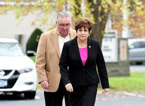 Colonie Town Supervisor Paula Mahan is accompanied by her husband Joseph as they enter the Latham Community Baptist Church polling place on Tuesday, Nov. 7, 2017, in Colonie, N.Y. (Will Waldron/Times Union)