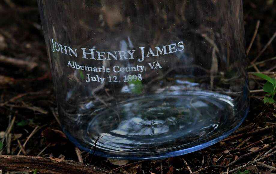A jar inscribed with the name John Henry James was later filled with soil from the site where he was lynched near Charlottesville, Va., in 1898. Photo: Washington Post Photo By Michael S. Williamson / The Washington Post
