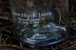 A jar inscribed with the name John Henry James was later filled with soil from the site where he was lynched near Charlottesville, Va., in 1898.
