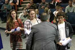Saratoga Springs High School students deliver petitions supporting re-arming school monitors to Superintendent Michael Patton during the Saratoga Springs School District's Board of Education meeting at the high school Tuesday, October 23, 2018. (Ed Burke photo-Special to The Times Union)