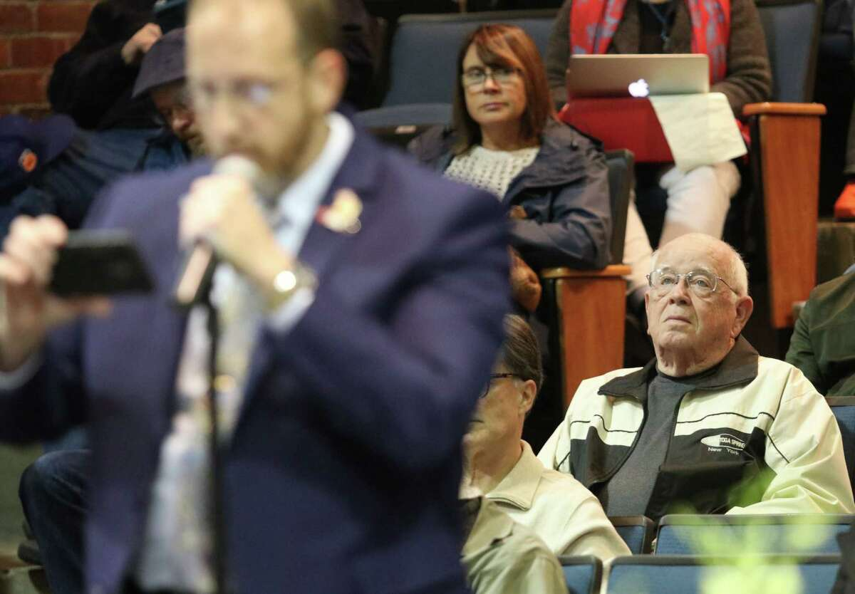 Former Dorothy Nolan Elementary School principal Don Hall listens as retired NYCPD Sgt. Joe Moran speaks in favor of re-arming school monitors during the Saratoga Springs School District's Board of Education meeting at the high school Tuesday, October 23, 2018. (Ed Burke photo-Special to The Times Union)