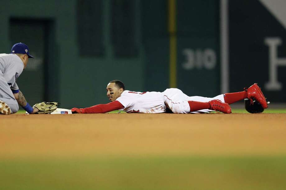 PHOTOS: A look at the Red Sox ALCS celebration at Minute Maid Park BOSTON, MA - OCTOBER 23:  Mookie Betts #50 of the Boston Red Sox steals second base during the first inning against Manny Machado #8 of the Los Angeles Dodgersin Game One of the 2018 World Series at Fenway Park on October 23, 2018 in Boston, Massachusetts. Photo: Maddie Meyer, Getty Images / 2018 Getty Images
