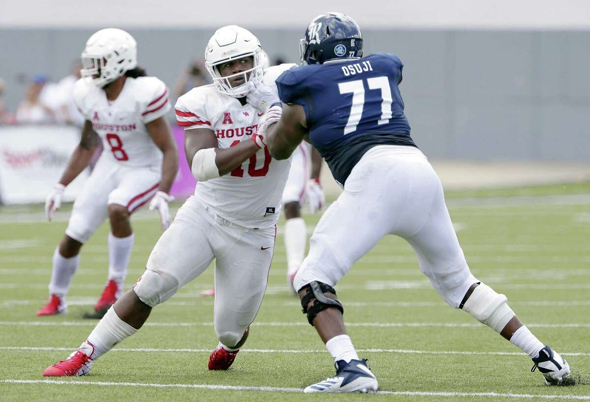 UH defensive tackle Ed Oliver, center, is used to being the central focus of an opponent's offensive line, but tactics employed have occasionally included the illegal chop block.