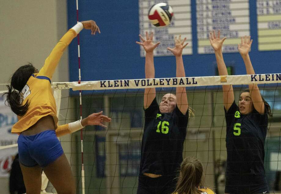 Annie Cook of College Park (16) and Abby Kremer of College Park (5) leap to block a kill from Nena Mbonu of Klein (12) during a District 15-6A match Tuesday, Oct. 23, 2018 at Klein High School in Klein. Photo: Cody Bahn, Houston Chronicle / Staff Photographer / © 2018 Houston Chronicle