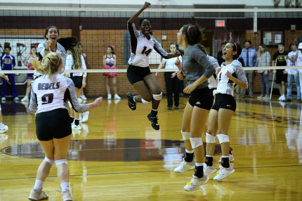 Lee volleyball players celebrate after scoring against Midland High Oct. 23, 2018, at Lee High School. James Durbin/Reporter-Telegram