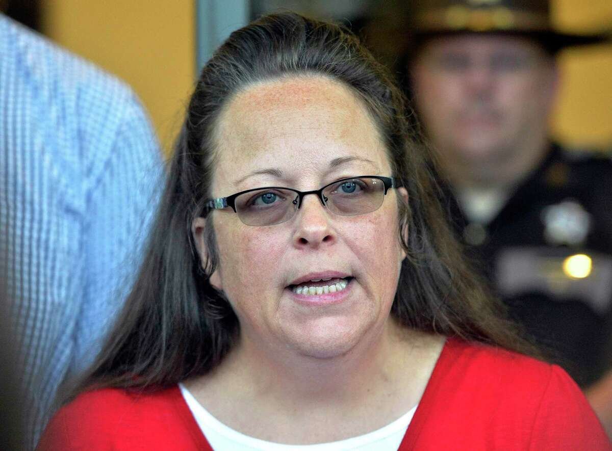 FILE - In this Sept. 14, 2015, file photo, Rowan County Clerk Kim Davis makes a statement to the media at the front door of the Rowan County Judicial Center in Morehead, Ky. Running for re-election, Davis, who was jailed for refusing to issue marriage licenses after gay weddings became legal, has told voters she did not treat anyone unfairly. Davis spoke at a candidate forum Tuesday night, Oct. 23, 2018, with her Democratic rival Elwood Caudill Jr.