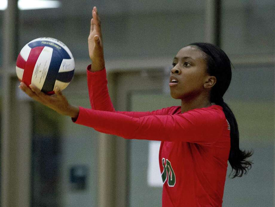 The Woodlands' Amanda Ifeanyi (10) serves the ball during the first set of a District 15-6A high school volleyball match at Klein High School, Tuesday, Oct. 9, 2018, in Spring. Photo: Jason Fochtman, Houston Chronicle / Staff Photographer / © 2018 Houston Chronicle