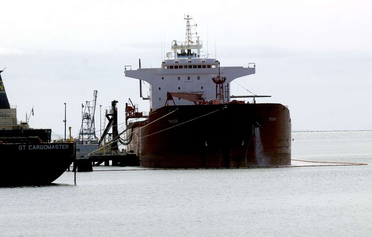 An oil tanker unloads fuel at a New Haven Harbor terminal.