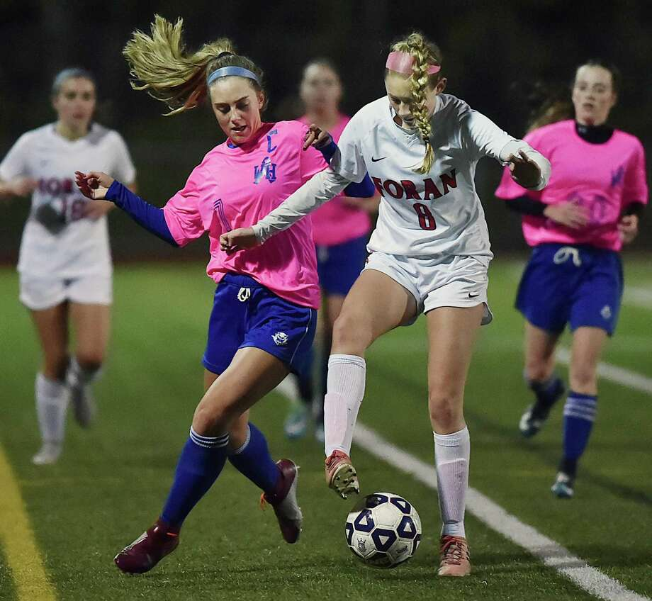 West Haven's Kelsey Gilmore battles Foran's Maxine Lynch on Tuesday at Ken Strong Stadium at West Haven High School. The Westies won, 1-0. Photo: Catherine Avalone / Hearst Connecticut Media / New Haven Register