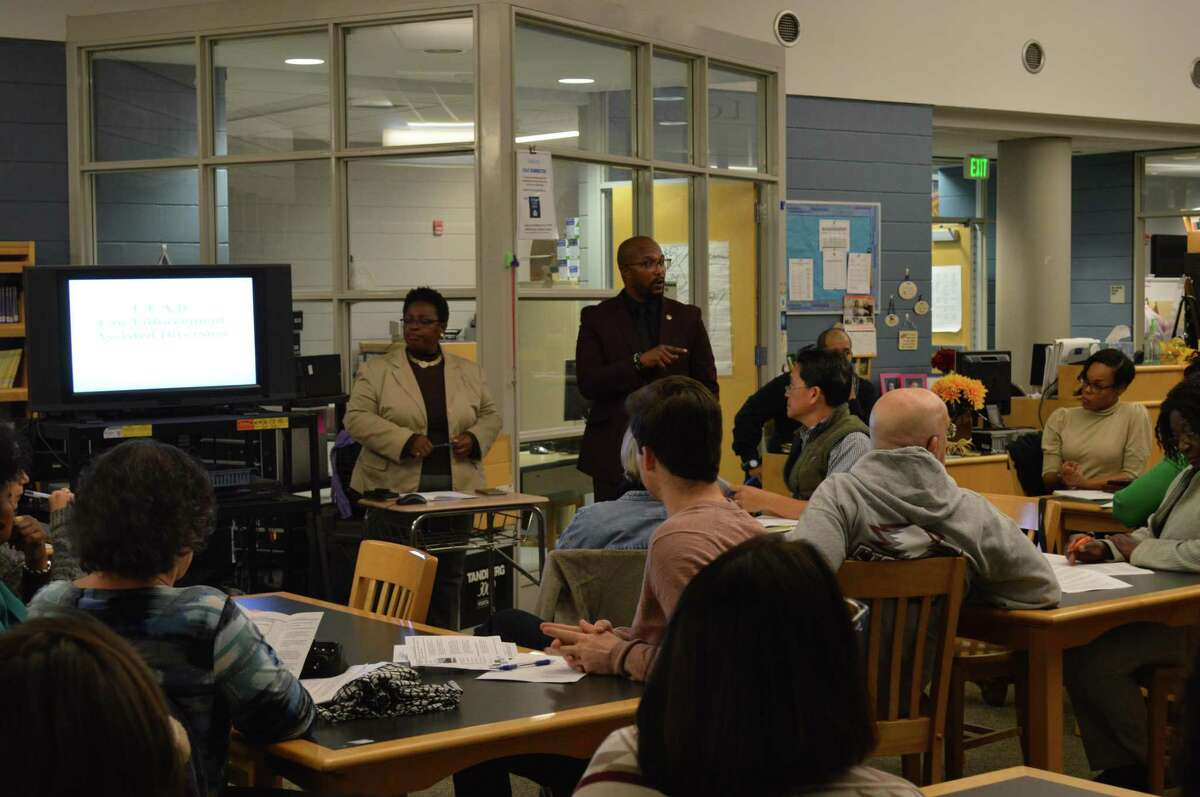 Community Administrator Dakibu Muley presents information about the the Law Enforcement Assisted Diversion program as the city begins to involve the community in policy development for the program.