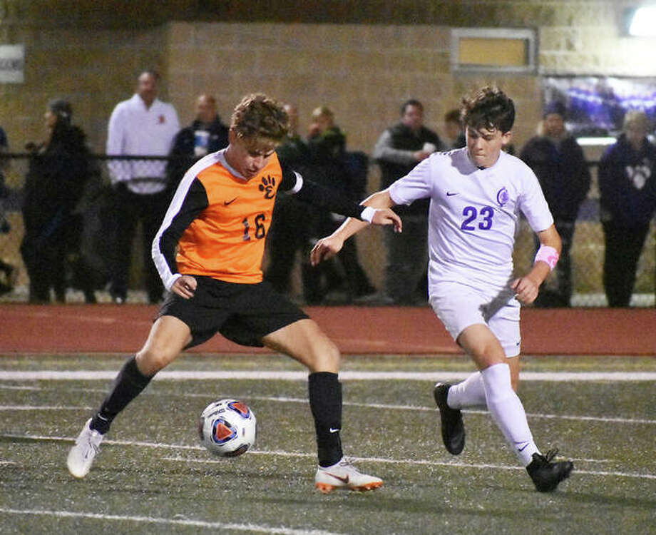 Edwardsville midfielder Josh Reed battles Collinsville's Spencer Vlasak for possession of the ball during the first half. Photo: Matt Kamp | For The Telegraph