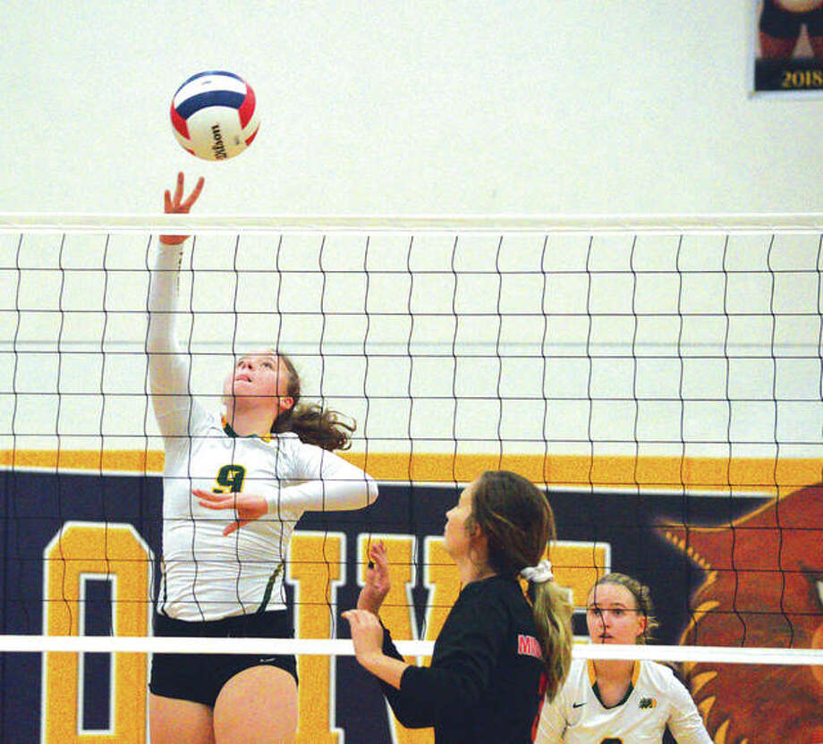 Metro-East Lutheran sophomore Caitlin Reynolds goes up for a kill during Tuesday's semifinal match against Bunker Hill at the Class 1A Mount Olive Regional. Photo: Scott Marion/Intelligencer