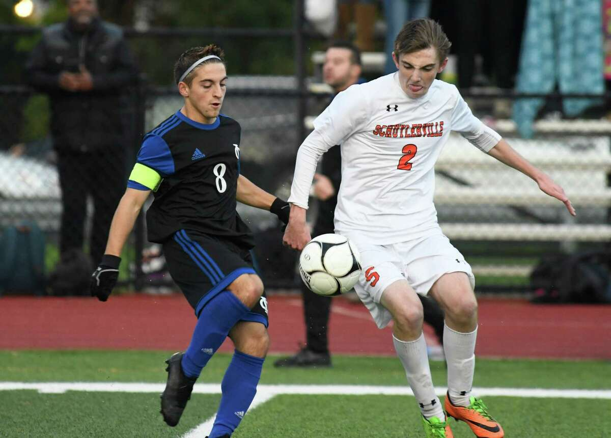 Schuylerville's Zach Saddlemire looks on as Ichabod Crane's Anthony Carlucci knees the ball during the Class B sectional boys soccer semifinals in Mohonasen, N.Y., on Tuesday, Oct. 23, 2018. (Jenn March, Special to the Times Union )