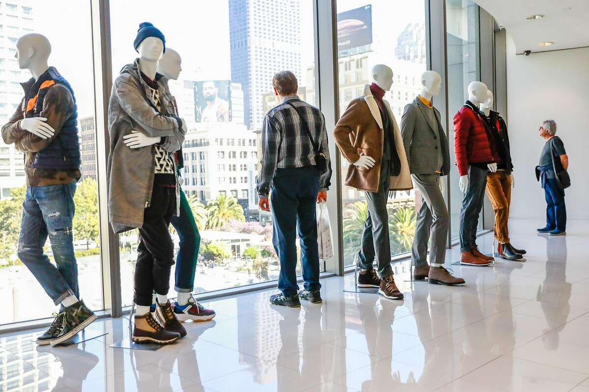 People check out the view of Union Square among mannequins on display in the men's department at Macy's in San Francisco, California, on Tuesday, Oct. 16, 2018.