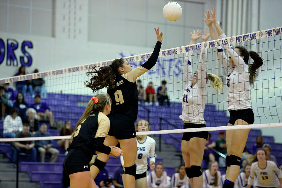 Vidor's Mallory Chilton hits the ball over the net as Port Neches-Groves' Maylin Louvier, left, and Kaitlyn Gil attempt to block during a volleyball game at Port Neches-Groves on Tuesday evening.   Photo taken Tuesday 10/23/18  Ryan Pelham/The Enterprise Photo: Ryan Pelham, The Enterprise / ©2018 The Beaumont Enterprise