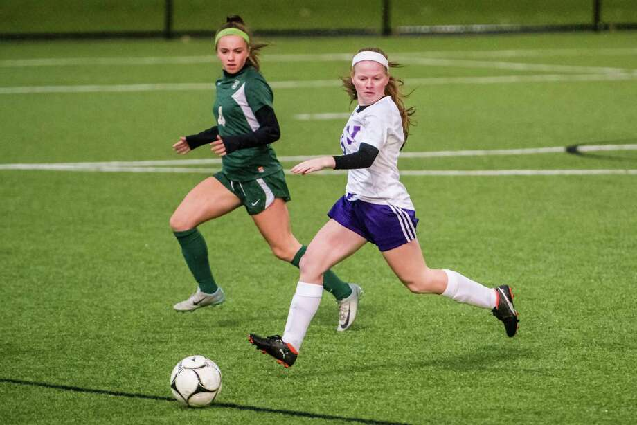 Voorheesville's Amanda Gillenwalters follows the ball as Schalmont's Madison Byrbes moves in during the class b girls' soccer semifinals that were held at Lansingburgh High School in Troy, NY Tuesday, October 23rd, 2018. Photo by Eric Jenks for the Times Union Photo: Eric Jenks / Eric Jenks 2018