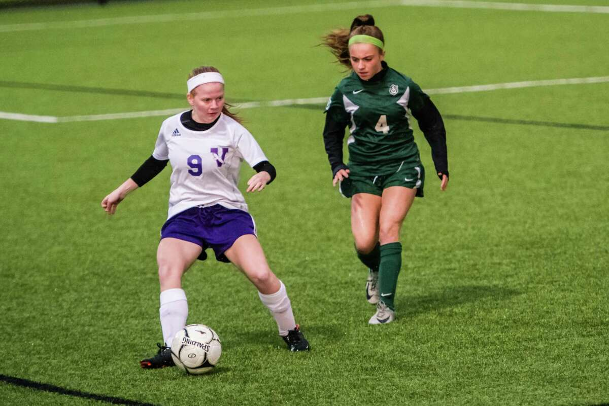 Voorheesville's Amanda Gillenwalters follows the ball as Schalmont's Madison Byrbes moves in during the class b girls' soccer semifinals that were held at Lansingburgh High School in Troy, NY Tuesday, October 23rd, 2018. Photo by Eric Jenks for the Times Union