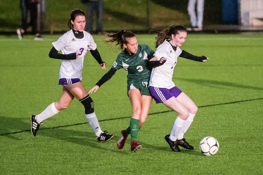 Schalmont's Ashley Cirilla fights for control with Voorheesville's Renee Bogdany as the class b girls' soccer semifinals were held at Lansingburgh High School in Troy, NY Tuesday, October 23rd, 2018. Photo by Eric Jenks for the Times Union