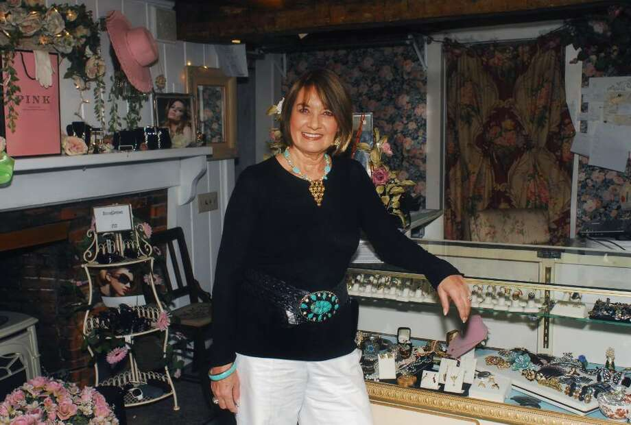 nt0906nwtshop-003  9/3/09 Newtown - Janet Falkenthal has owned the Fashion Exchange, an upscale consignment shop in Newtown, for 25 years. She has just opened another shop in Danbury on Padanaram Road.  Photo by Krista Hicks Benson Photo: Krista Hicks Benson / The News-Times