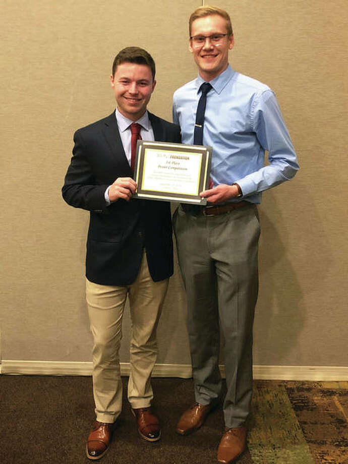 SIUE student researchers Brentsen Wolf, left, and Gregory Takacs earned first place for scientific merit at the Illinois Pharmacists Association September meeting. Photo: SIUE Photo