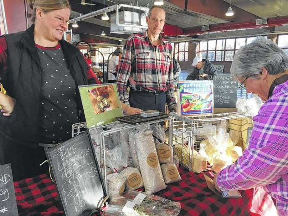 Beth (left) and Doug Rinkenberger of Garden Gate Farm help a customer during the 2017 Holiday Farmers Market in Springfield. The capital's downtown farmers market is moving toward being a year-round venture. Photo: Photo Provided