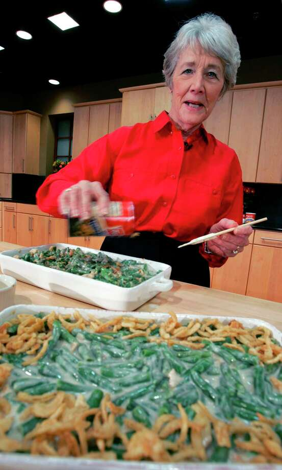 FILE - In this Nov. 15, 2005 file photo, a Green Bean Cassorole sits in the foreground as Dorcas Reilly prepares another at the Campbell Soup Co. corporate kitchen in Camden, N.J.  Reilly died on Monday, Oct. 15, 2018 and her family will celebrate her life on Saturday, Oct. 27 in the town where she lived, Haddonfield, N.J. Reilly was a Campbell Soup kitchen supervisor in 1955 when she combined green beans and cream of mushroom soup, topped with crunchy fried onions, for an Associated Press feature. It is the most popular recipe ever to come out of the corporate kitchen at Campbell Soup. Photo: MEL EVANS, AP / AP2005