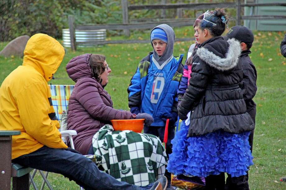 Campers at Port Crescent State Park take part in trick-or-treating during the campground's Harvest Festival Saturday night. Photo: Mike Gallagher/Huron Daily Tribune