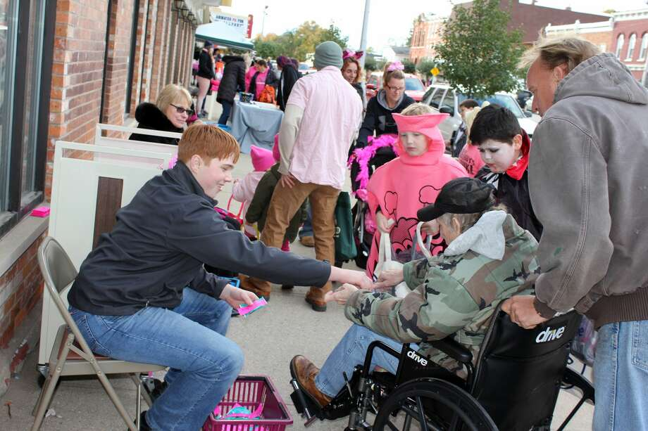 Crowd estimates for Cass City's 2018 Pink-or-Treat ranged between 900 and 1,000 participants. Dozens of businesses lined Main Street and passed out goodies. The annual event is part of Pinktober, a month-long breast cancer awareness drive that the entire village participates in. Photo: Brenda Battel/Huron Daily Tribune