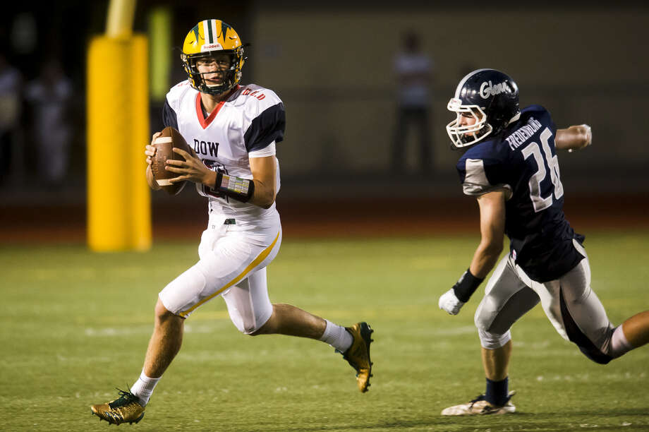 Dow High quarterback Shane Astrike looks for an open receiver during a Sept. 14, 2018 game against John Glenn. Photo: Daily News File Photo