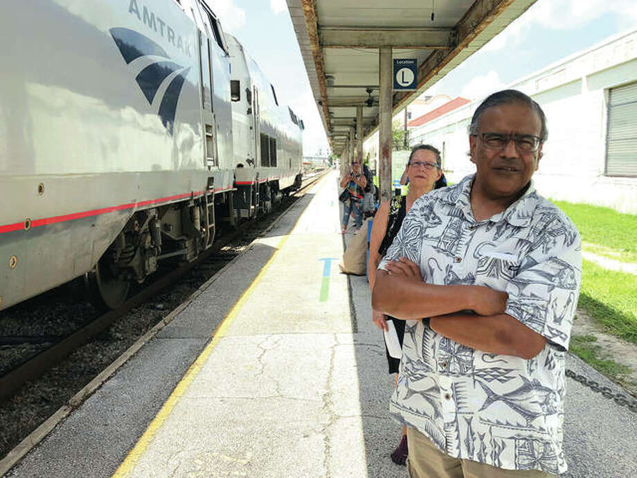 In this Aug. 9, 2018 photo, Jishnu Mukerji and Penny Jacobs wait to board an Amtrak train in Orlando, Fla. Mukerji and Jacobs became friends from online train forums that get other rail enthusiasts together for trips around the United States. They were headed to Pennsylvania for a memorial service for one of the members in their train group who died of a heart attack in July while traveling with his train buddies to New Orleans. Photo: Associated Press