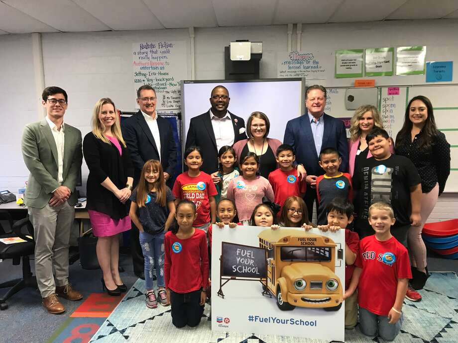 From left to right: Chevron representatives Jeffrey Cavanagh, Catie Matthews, Don Puckett, MISD Superintendent Orlando Riddick, 2nd Grade Teacher Reagan Hughes, Kent Kwik representatives Bill Kent, Meredith Bright, Katie Roberts and representatives from Lamar Elementary's 2nd Grade class Photo: Courtesy Photo