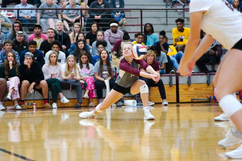 Pearland's Katie Whitehead (11) digs down to make a set against George Ranch Tuesday. Oct. 23 at Pearland High School. Photo: Kirk Sides/Houston Chronicle